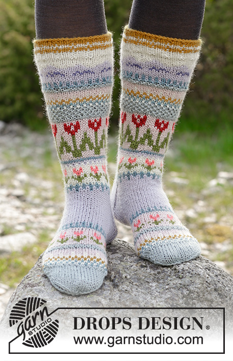 Always Winter / DROPS 179-36 - Knitted socks with multi-colored Norwegian pattern. 