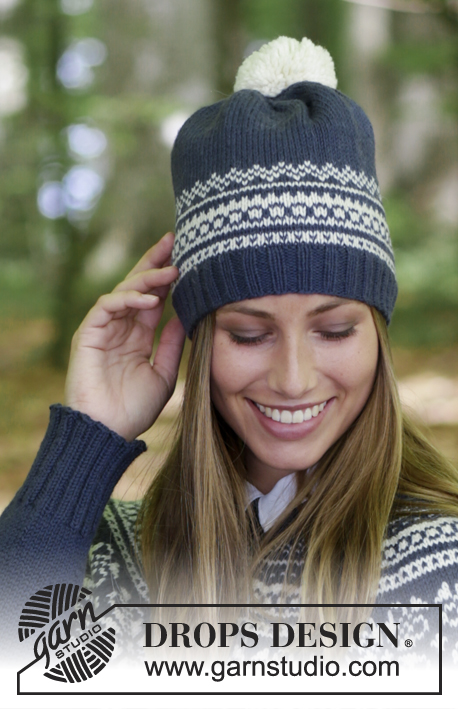 Lofoten Hat / DROPS 181-11 - Hat with multi-colored Norwegian pattern and pom pom.