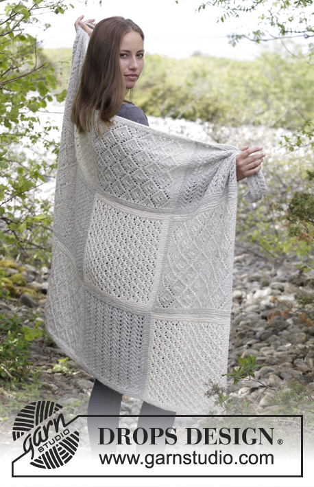 Twelve Clouds / DROPS 181-32 - Knitted blanket with squares in lace pattern.