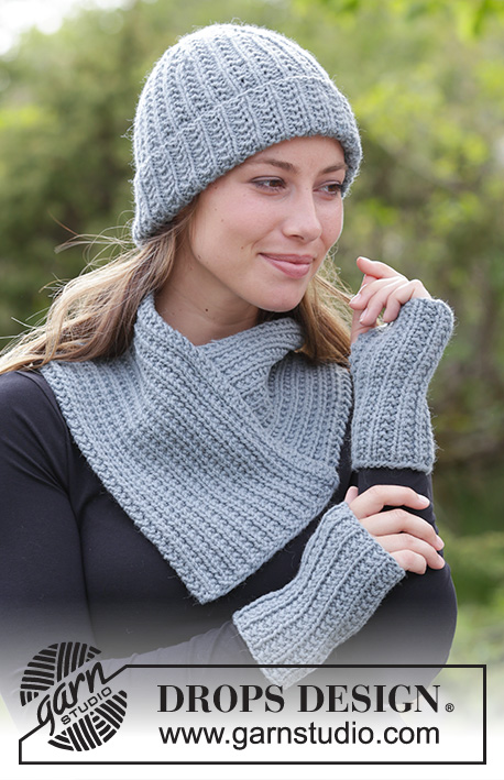 Warm Snap / DROPS 182-17 - The set consists of: Knitted hat, neck warmer and wrist warmers with textured pattern.