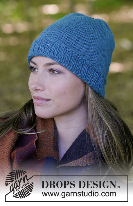 Tamineh / DROPS 182-23 - Knitted hat with edge in rib.