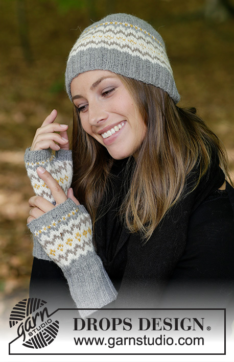 Nanette / DROPS 182-24 - The set consists of: Knitted hat and wrist warmers with multi-coloured Nordic pattern.