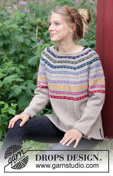 Rainbow Hugs / DROPS 183-25 - Knitted jumper with round yoke, stripes, multi-coloured pattern, worked top down with split in sides. Sizes S - XXXL. The piece is worked in DROPS Nepal.