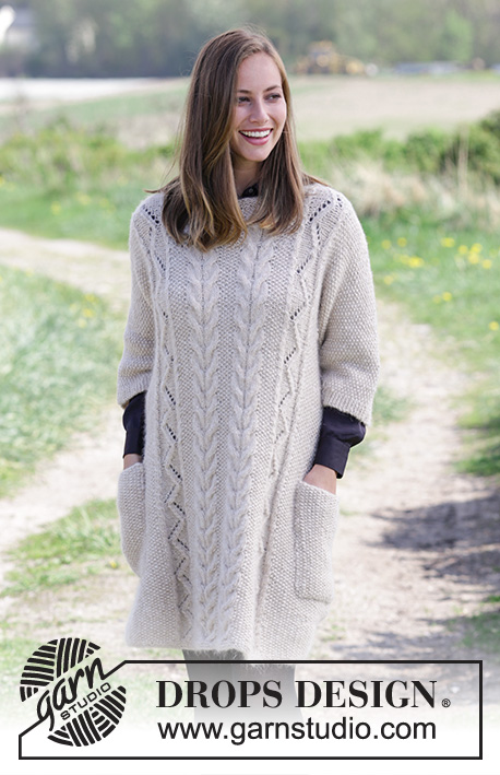 Elegant Comfort / DROPS 184-2 - Knitted jumper with moss stitch, cables, lace pattern and pockets. Sizes S - XXXL. The piece is worked in DROPS Air.