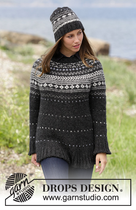 Night Shade / DROPS 184-26 - Set consists of: Jumper with round yoke and multi-coloured Norwegian pattern, worked top down. Hat with multi-coloured Norwegian pattern. Size: S - XXXL