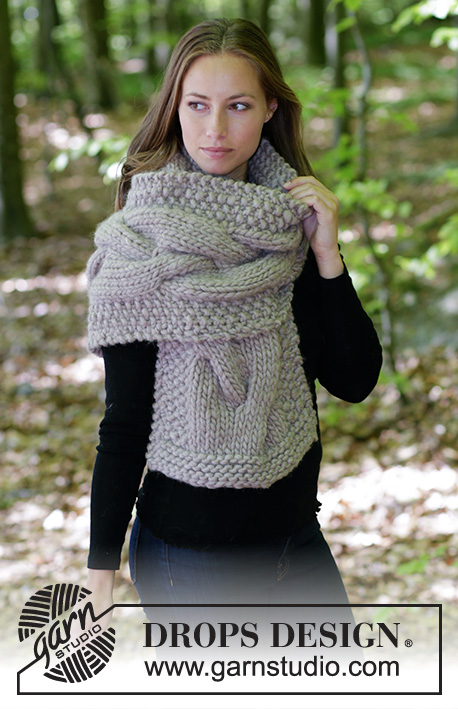 Noelia / DROPS 184-33 - Knitted scarf with cables and moss stitch.
