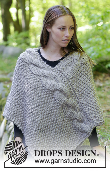Noelia Poncho / DROPS 184-34 - Knitted poncho with cables and moss stitch. Size: S - XXXL