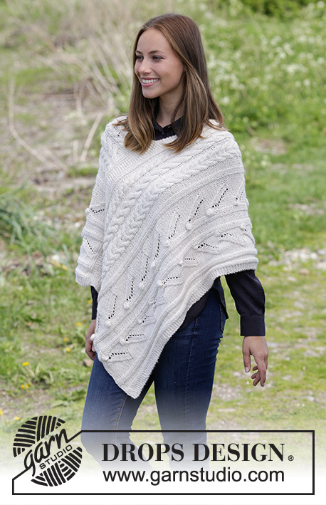 Winter's Heart / DROPS 184-5 - Knitted poncho with cables, bubbles and lace pattern. Sizes S - XXXL.