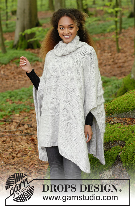 Snow Queen / DROPS 184-6 - Sideways knitted poncho with cables and high collar. Sizes S - XXXL.