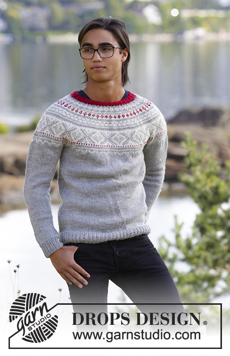 Narvik / DROPS 185-6 - The set consists of: Men's knitted jumper with round yoke and multi-coloured Nordic pattern, worked top down and men's knitted hat with multi-coloured Nordic pattern. Sizes S - XXXL.  