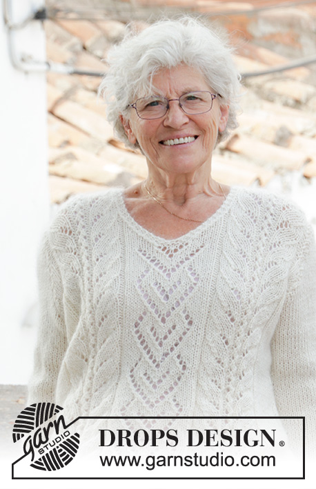 The Pearl / DROPS 186-31 - Knitted jumper with lace pattern and V-neck. Sizes S - XXXL. The piece is worked in DROPS Alpaca and DROPS Kid-Silk.