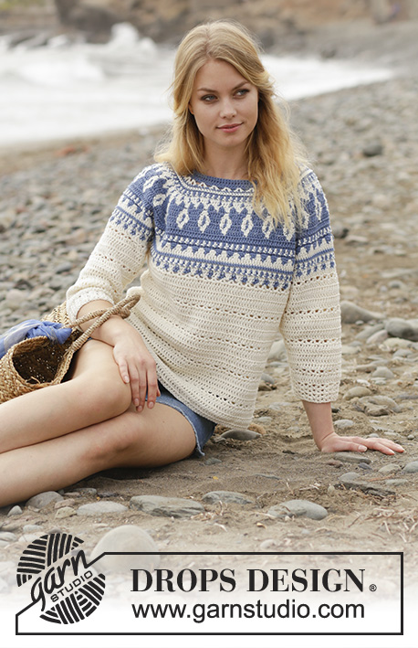 Nordic Fling / DROPS 186-34 - Sweater with multi-colored pattern and round yoke, crocheted top down with 3/4 long sleeves and A-shape. Size: S - XXXL Piece is crocheted in DROPS Cotton Merino.
