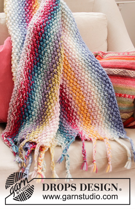 Jalisco / DROPS 189-1 - Knitted rainbow blanket with seed stitch, stripes and fringe. The piece is worked in 2 strands DROPS Snow.