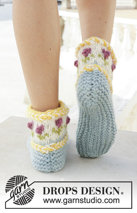 Spring Buds / DROPS 189-34 - Knitted slippers with Latvian cable and multi-coloured Norwegian pattern. Sizes 35 - 43. The piece is worked in DROPS Eskimo.