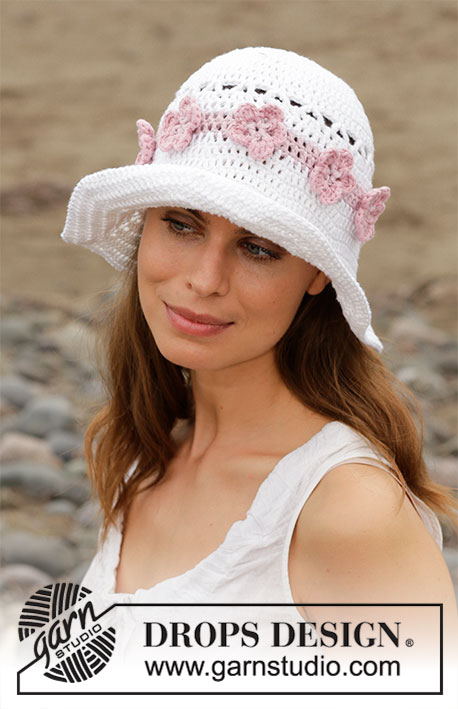 Summer Azalea / DROPS 190-20 - Crocheted hat with lace pattern and flowers. The piece is worked in DROPS 