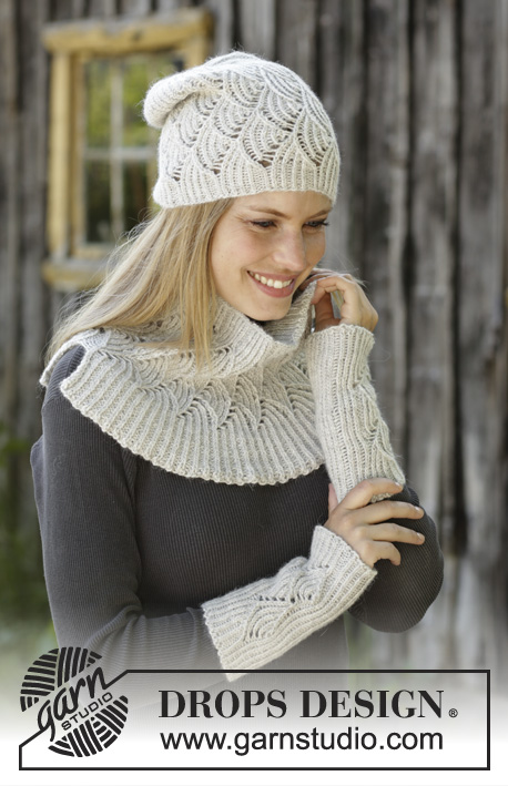 Winter Dunes / DROPS 192-21 - Knitted hat, neck warmer and wrist warmers in DROPS Puna. Set is knitted in rib with fan pattern.