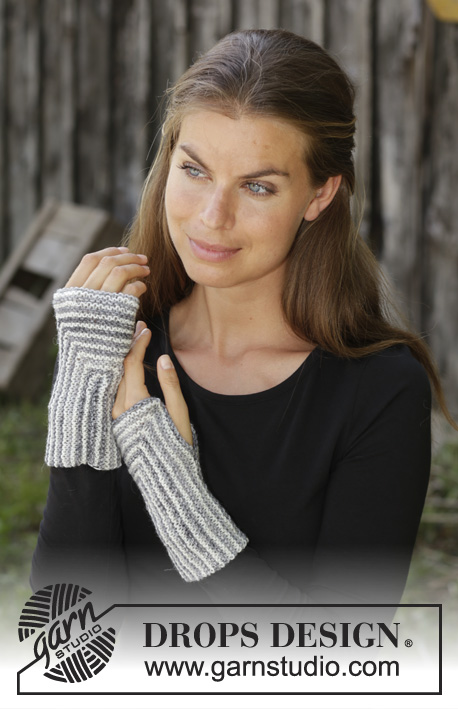 Beatrix / DROPS 192-47 - Knitted wrist warmer in DROPS Fabel. Piece is knitted back and forth in an angle with stripes.