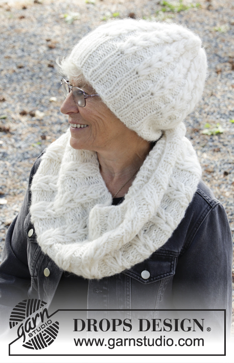 Dancing Snow / DROPS 192-9 - Knitted hat in DROPS Air and DROPS Brushed Alpaca Silk. Piece is knitted in the round with texture.