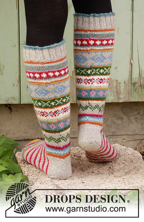 Winter Carnival Socks / DROPS 193-1 - Knitted socks in DROPS Karisma. The piece is worked with stripes and Nordic pattern. Sizes 35 - 46.