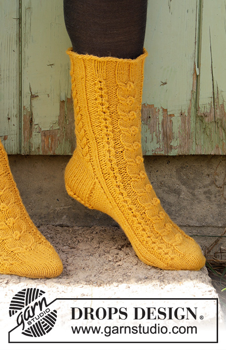 Happy Day / DROPS 193-4 - Knitted socks with cables in DROPS Lima. Size 35 to 43