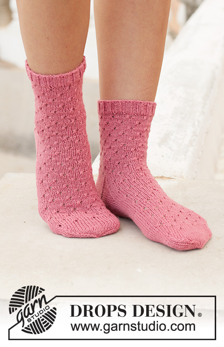 Springtide Dance / DROPS 198-10 - Knitted socks in DROPS Nord. Piece is knitted top down with simple lace pattern. Size 35 to 43 = 5 to 10 1/2
