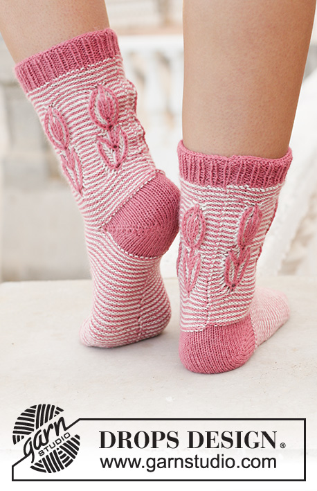 Spring Brings / DROPS 198-15 - Knitted toe-up socks in DROPS Nord. The piece is worked with stripes and 2-colored flower in English rib on the leg. Sizes 35 – 43 = 5 - 10 1/2.