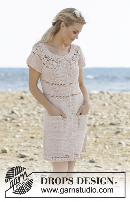 Sandy Shores / DROPS 199-17 - Crocheted dress with round yoke in DROPS Cotton Merino. Piece is crocheted top down with lace pattern, buttons and pockets. Size: S - XXXL