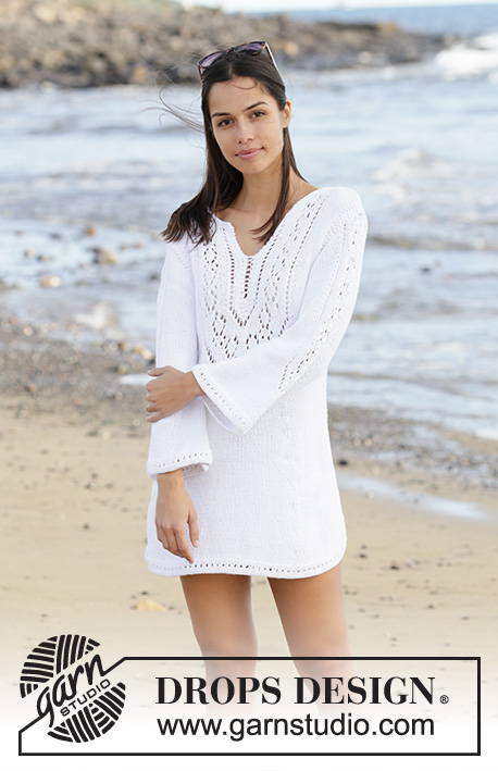 White Pearl / DROPS 199-2 - Knitted dress in DROPS Paris. The piece is worked with lace pattern, split in front of neck and ¾ length trumpet sleeves with lace pattern. Sizes S - XXXL.
