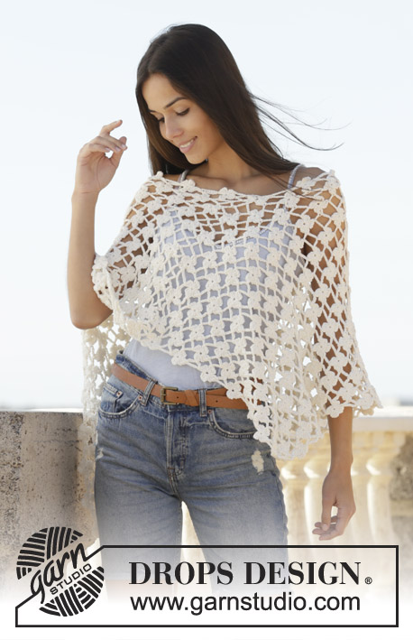 Sweet Jasmine / DROPS 200-38 - Crocheted poncho in DROPS Merino Extra Fine. The piece is worked with flower pattern. Sizes S - XXXL.