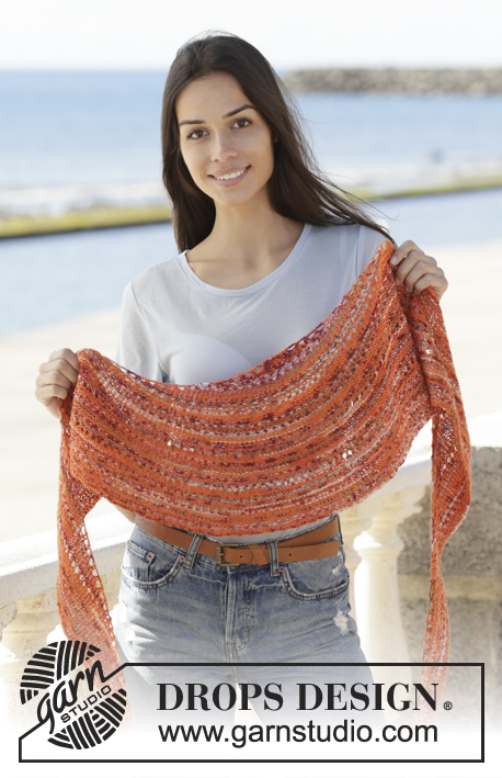 Solar Flares / DROPS 202-38 - Knitted shawl in DROPS Fabel. The piece is worked back and forth with garter stitch and rows of holes.