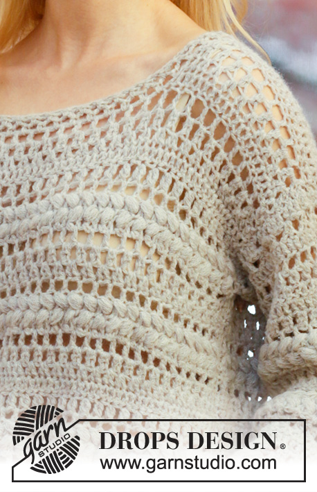 Algarve / DROPS 202-4 - Crocheted jumper with puff stitches in DROPS Sky. The piece is worked top down with lace pattern, long split and ¾-length sleeves. Sizes S - XXXL.