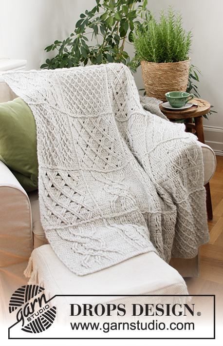 Celtic Comfort / DROPS 203-1 - Crocheted blanket in DROPS Air. The piece is worked in squares with cables and relief stitches.