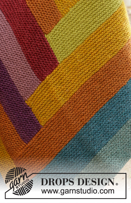 Abstract Rainbow / DROPS 203-2 - Knitted blanket in DROPS Eskimo. The piece is worked with garter stitch and stripes.
