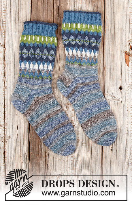 Faraway Fair Isle / DROPS 203-28 - Knitted socks in DROPS Fabel. Piece is knitted top down with Nordic pattern. Size 35 to 43