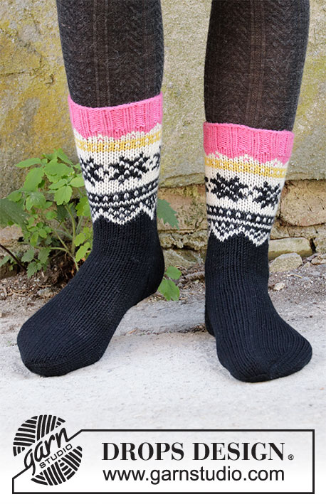 Midnight Snow / DROPS 203-33 - Knitted socks in DROPS Lima. The piece is worked top down with Nordic pattern. Sizes 32-43 = 13-10 1/2.