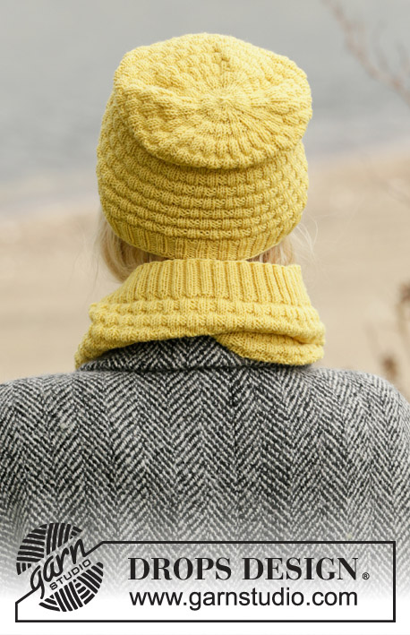 Follow the Sun / DROPS 204-6 - Knitted hat, neck warmer and wrist warmer in DROPS BabyMerino. The piece is worked with texture and ribbed edges.