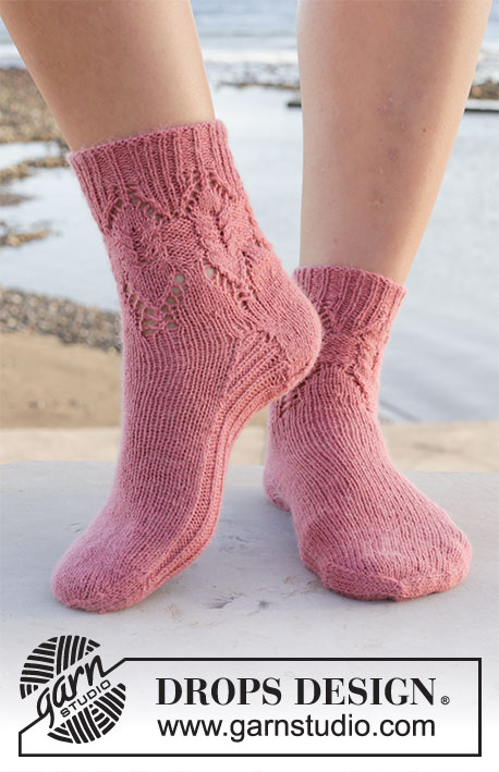 Rambling Roses / DROPS 209-26 - Knitted socks in DROPS Nord. Piece is knitted top down with cables and lace pattern. Size 35 to 43