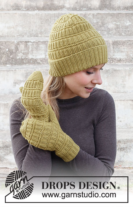 Honey Sweet / DROPS 214-39 - Knitted hat and mittens in DROPS Merino Extra Fine. Piece is knitted with textured pattern.