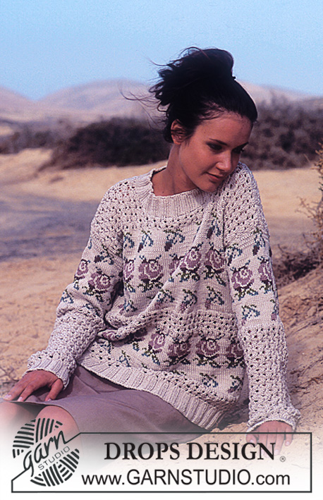 DROPS 64-3 - DROPS Sweater in Muskat with lace and rose pattern.