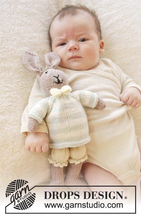 Mr. Bunny / DROPS Baby 25-8 - Knitted bunny toy with pants, jumper and bow in DROPS BabyMerino