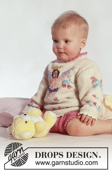 "Little Angel / DROPS Baby 3-16 - DROPS jumper with angel motif in ""Paris"" and shorts in ""Safran""."