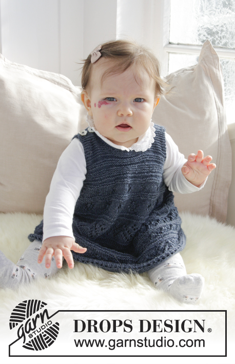 Serafina / DROPS Baby 31-17 - Knitted dress with lace pattern and garter stitch for baby. Size 0 - 4 years Piece is knitted in DROPS Alpaca.