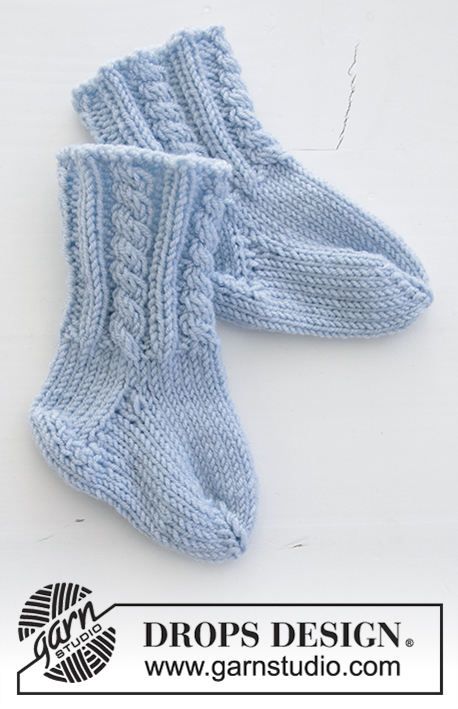 Celestina Socks / DROPS Baby 31-8 - Knitted baby socks with cables. Sizes premature - 3/4 years. Piece is worked in DROPS BabyMerino.