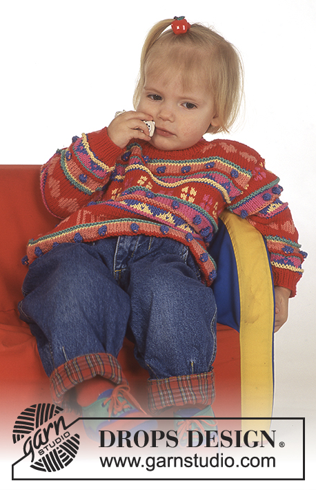 "Hearts and Flowers / DROPS Baby 4-7 - DROPS jumper with hearts and pattern borders in ""Muskat""."