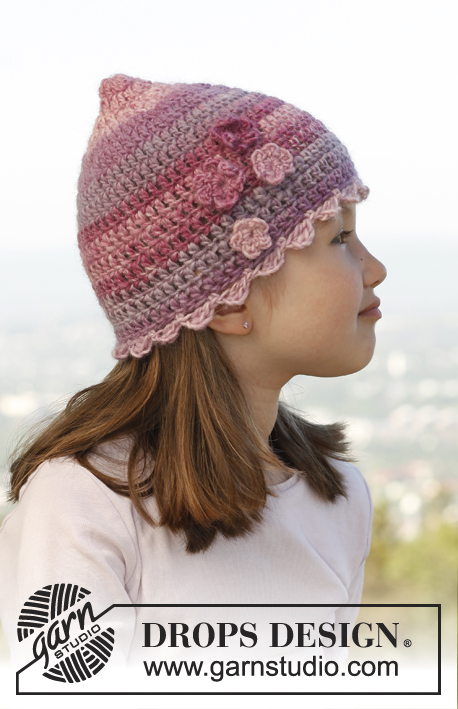 Arwen / DROPS Children 23-37 - Crochet hat with flowers in DROPS Big Delight.
