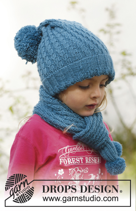 Sea dream / DROPS Children 23-5 - Knitted hat with pompom and scarf with diagonal rib pattern in DROPS Merino Extra Fine. Size children 3 to 12 years.