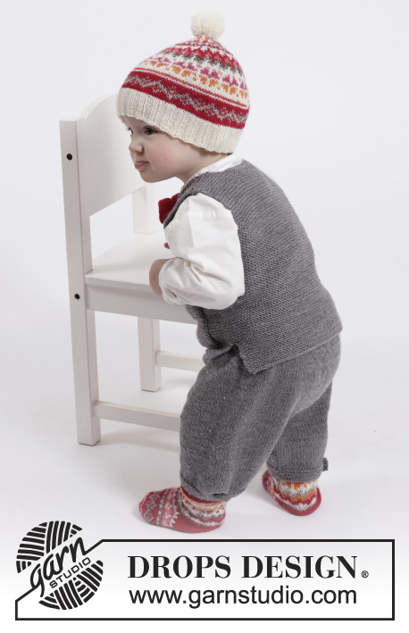 Goofy Gavin / DROPS Children 26-15 - Set of knitted vest with pockets and v-neck and knee pants in stocking st in DROPS BabyMerino, plus knitted hat and socks with Nordic pattern and bow in garter st in DROPS Fabel. For baby and children in size 1 month - 6 years.