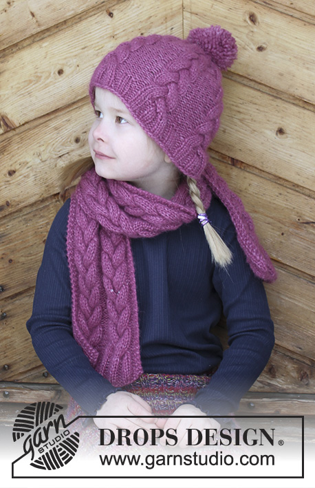 Berry Wrap / DROPS Children 30-16 - Set consists of: Knitted hat and scarf with cables for kids. Size 2 - 10 years Set is knitted in DROPS Air.