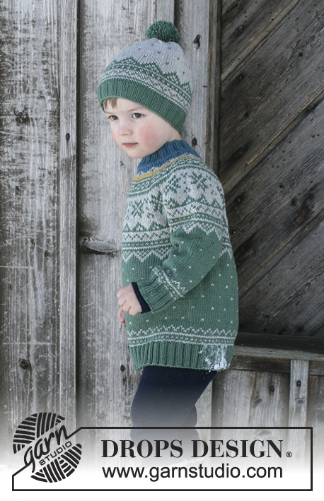 Seiland Jumper / DROPS Children 30-5 - Set consists of: Jumper for kids with round yoke and multi-coloured Norwegian pattern, worked top down. Hat with multi-coloured Norwegian pattern and pompom. Size 2 - 12 years Set is knitted in DROPS Merino Extra Fine.
