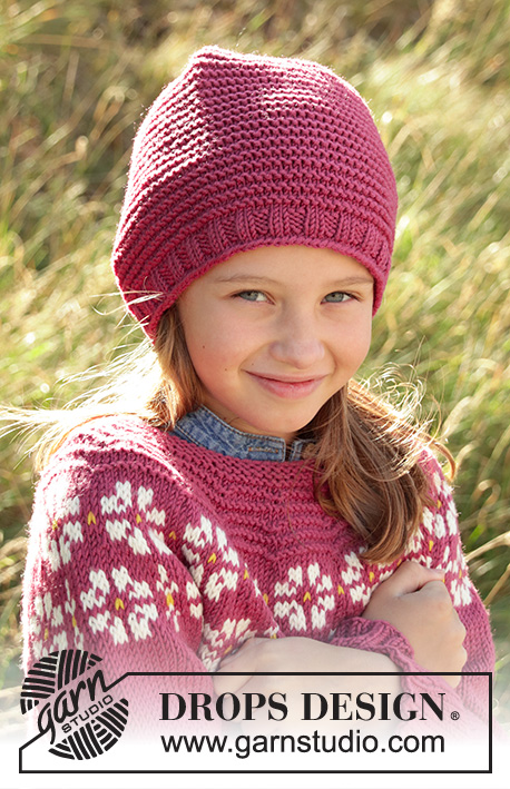Daisy Delight Hat / DROPS Children 34-6 - Knitted hat for children in DROPS Merino Extra Fine or DROPS Lima. The piece is worked in the round, bottom up with garter stitch and stocking stitch. Sizes 3-12 years.